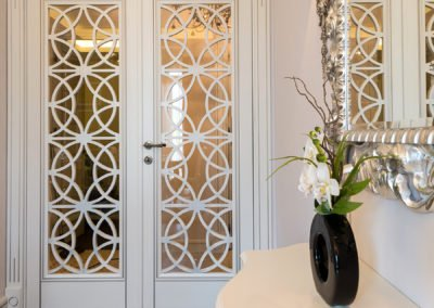 White wooden door with decorative details